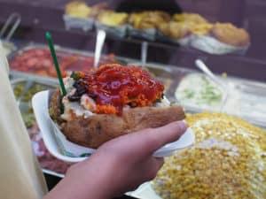 Eating kumpir in Ortaköy, Istanbul.