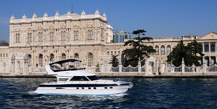 Private Bosphorus cruise yacht Zoe in front of Dolmabahçe Palace.