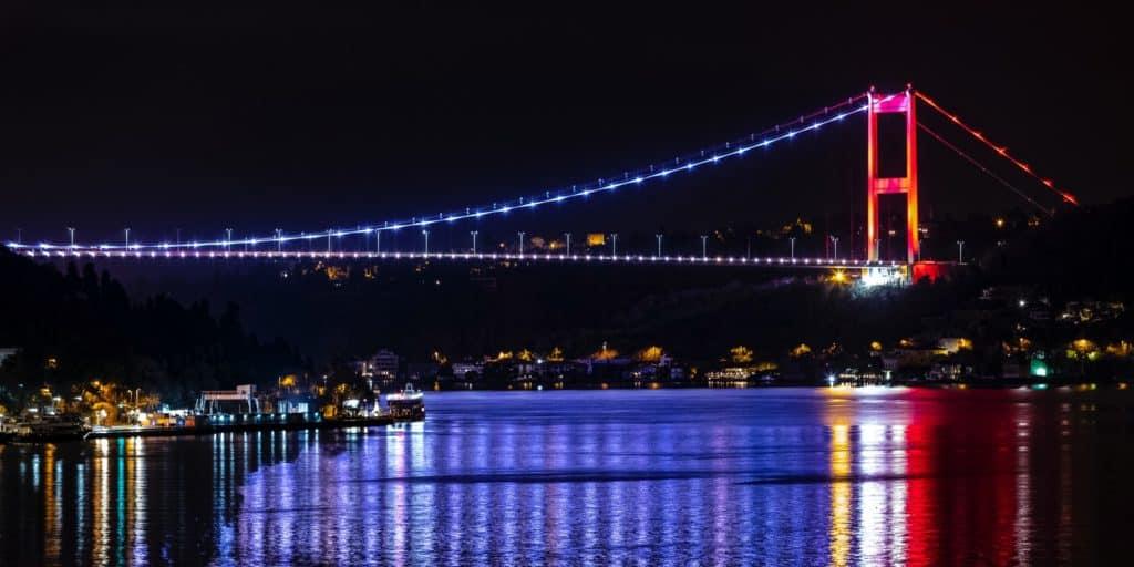 Illuminated Bosphorus Bridge at night in Istanbul, Turkey.